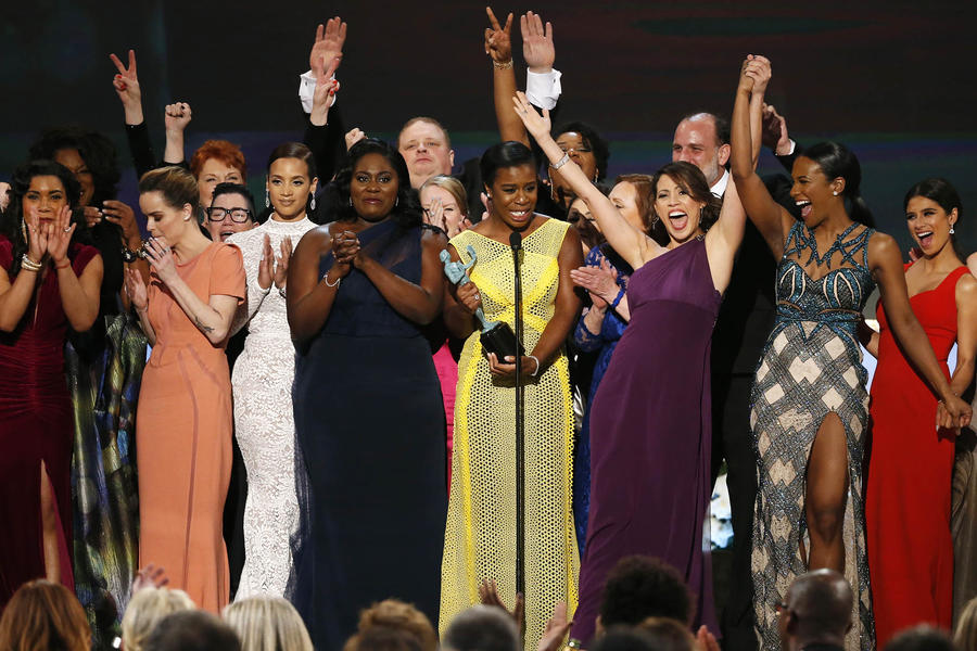 "Image #: 34508221 Uzo Aduba (C), of the Netflix series ""Orange is the New Black,"" accepts the award for Outstanding Performance by an Ensemble in a Comedy Series along with her fellow cast members at the 21st annual Screen Actors Guild Awards in Los Angeles, California January 25, 2015. REUTERS/Mario Anzuoni (UNITED STATES - Tags: ENTERTAINMENT TPX IMAGES OF THE DAY) (SAGAWARDS-SHOW) REUTERS /MARIO ANZUONI /LANDOV"